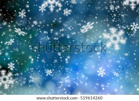 Christmas abstract bokeh background with snow flakes.