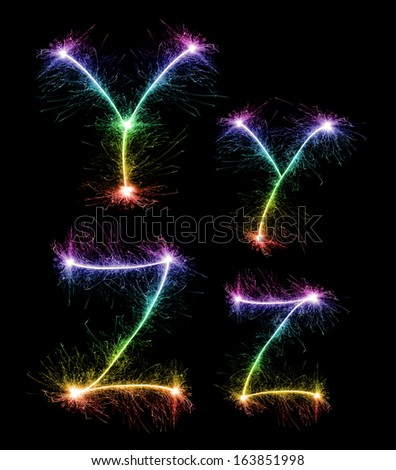 Christmas alphabet created a sparkler,letter y,letter z - stock photo