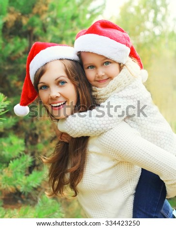 Christmas and family concept - happy mother and child having fun together