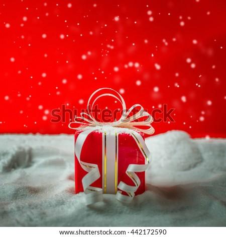 Christmas and gift box on snow. - stock photo
