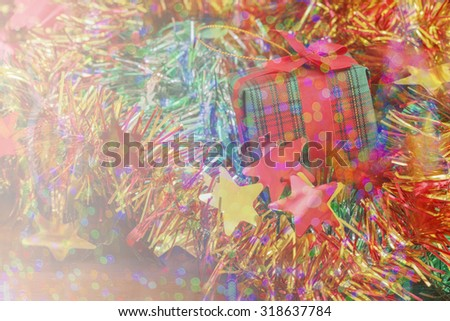 Christmas and Happy new year Gifts box on wood table background of de-focused lights on soft focus.