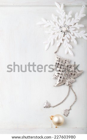 Christmas and New Year background. Snowflake, Christmas tree and ball on a white wooden background. Copy space. - stock photo