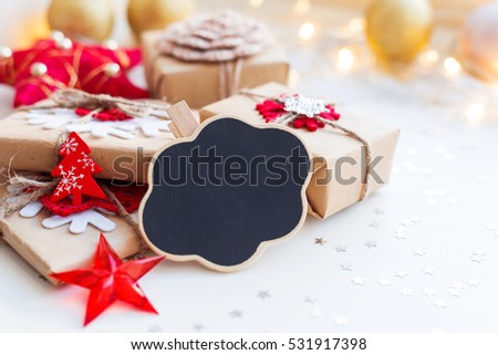 Christmas and New Year background with cloud chalkboard, presents and decorations for Christmas tree. Holiday background with stars confetti and light bulbs. Place for text.