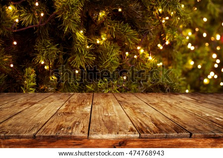 Christmas new year background empty dark stock photo 474768943 christmas and new year background with empty dark wooden deck table over christmas tree and blurred mozeypictures Gallery