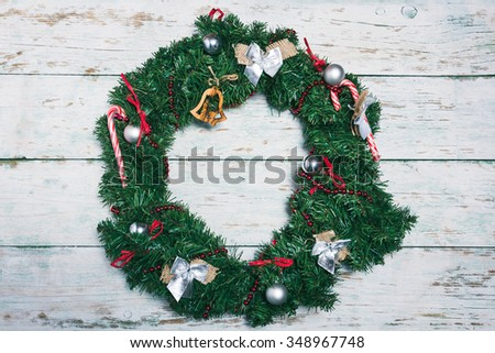 Christmas and New Year background with wreath on white vintage wooden plank