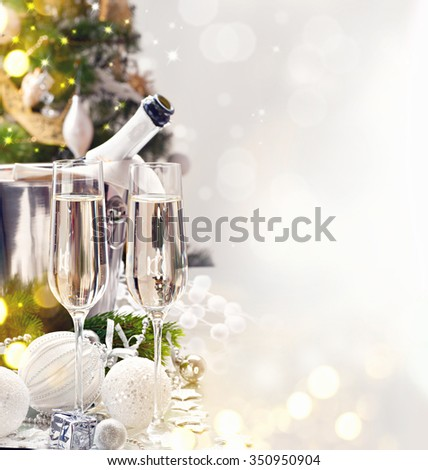 Christmas and New Year celebration with champagne. Holiday dinner table setting with Christmas decoration and sparkling wine. Champagne - stock photo