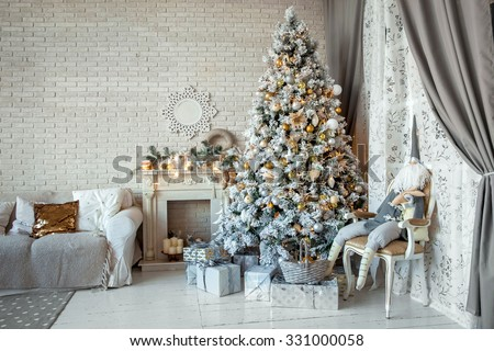 Christmas and New Year decorated interior room with presents and New year tree - stock photo