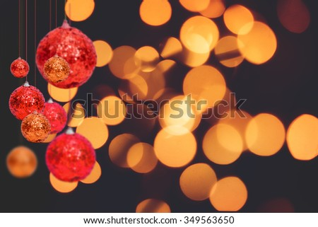 Christmas and New Year Decoration. Bauble hanging on bokeh background - stock photo