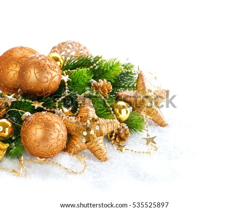 Christmas and New Year Decoration over white wood background. Brown Border art design with holiday baubles. Beautiful Christmas tree closeup decorated with ball, stars, garland. Golden color, vintage