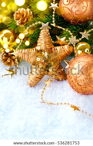 Christmas and New Year Decoration over white wood background. Brown Border art design with holiday baubles. Beautiful Christmas tree closeup decorated with ball, stars, garland. Golden color, vintage.
