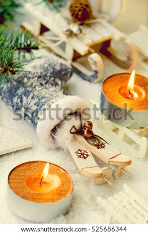Christmas and New Year decoration with boot, sleds, skiing, candles, fir branch and snow