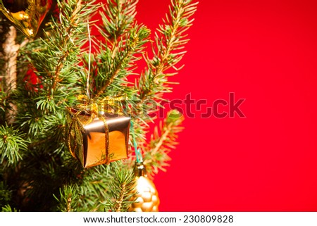 Christmas and New Year decoration with shiny glare on a red background