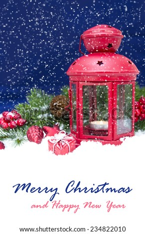 Christmas and New Year Decorations isolated on a blue background. lantern light and tinsel  - stock photo