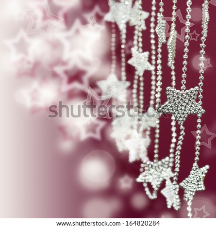 Christmas and New Year Decorations. Stars garland on pink blur background - stock photo