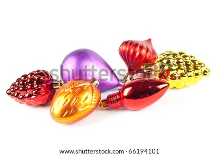 Christmas and new-year decorations. Varicoloured christmas toys on white background - stock photo
