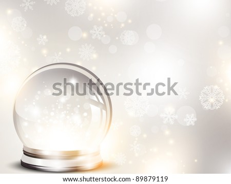 Christmas and New year holiday background with glass ball and snow over blue
