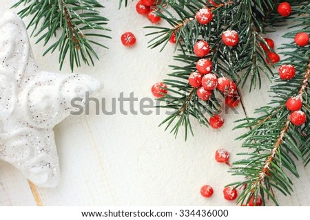 Christmas and New year holiday framed card copyspace background, green natural snowy fir tree boughs bright berries, star decor,white backdrop - stock photo