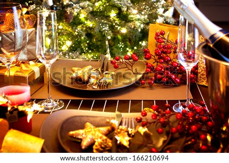 Christmas And New Year Holiday Table Setting with Champagne. Celebration. Place setting for Christmas Dinner. Holiday Decorations. Decor.  - stock photo