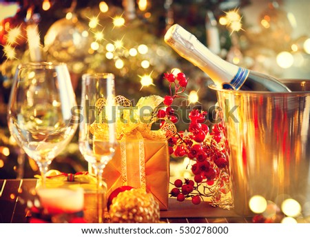 Christmas And New Year Holiday Table Setting with Champagne. Celebration. Place setting for Christmas Dinner. Holiday Decorations. Decor. Served Table.