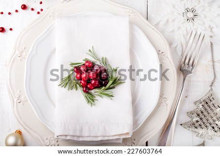 Christmas And New Year Holiday Table Setting with cranberry and rosemary decoration,-Holiday decoration. - stock photo