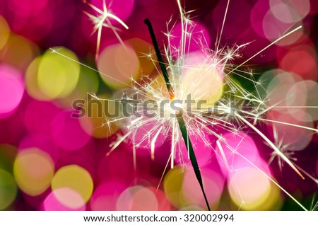 Christmas and new year party sparkler on bokeh background - stock photo