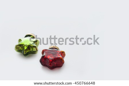 Christmas and new year red and green toys. Glassy vintage stars on a light background - stock photo