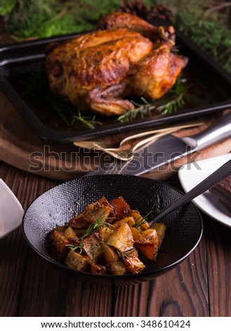 Christmas and new year's eve dinner: roasted whole chicken / turkey, sweet potato salad and dessert - stock photo