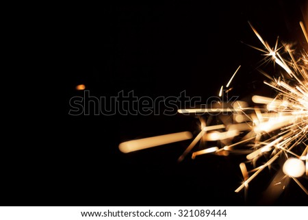Christmas and newyear party sparkler on black background. Copyspace - stock photo