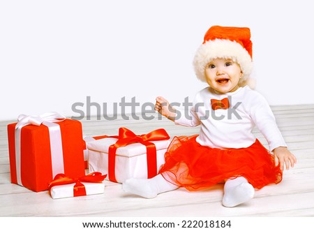 Christmas and people concept - happy baby with gifts  - stock photo