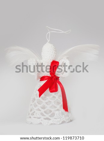 Christmas angel decoration knitted. Home made knitted angel isolated on white background