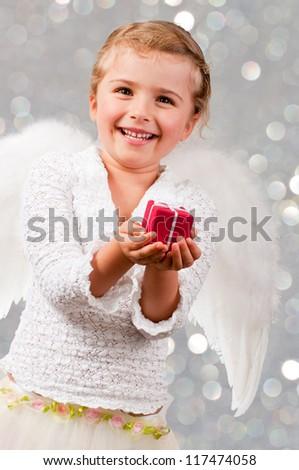 Christmas, Angel - lovely little girl celebrating Christmas - stock photo