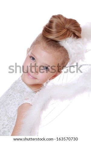 Christmas Angel - lovely little praying girl isolated on white background on Holiday theme/Portrait of cute Christmas angel wearing white dress and pretty wings
