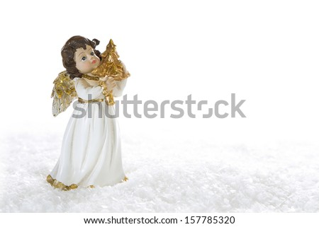 Christmas angel playing golden harp isolated on white background with snow - stock photo