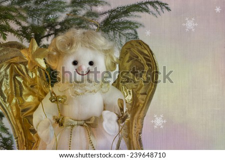 Christmas angel toy with the gold wings on winter background. Christmas angel decoration - stock photo