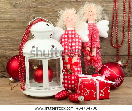 Christmas angels, gift box and Christmas balls on a wooden background. - stock photo