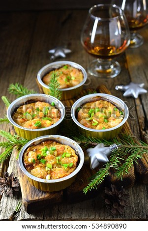 Christmas appetizer baked proportion on a wooden background new year