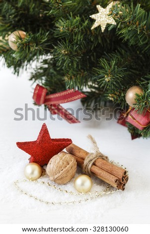 Christmas arrangement, cinnamon sticks and decoration - stock photo