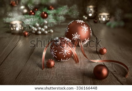 Christmas arrangement in red and white on wooden table. Merry Christmas! This image is toned - stock photo