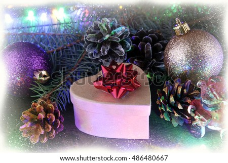 Christmas arrangement of fir branches, cones, shiny balls, garlands with multicolored lamps and gift box with a red bow with treatment effect of white frost on the contour.