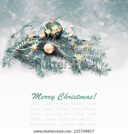 Christmas arrangement on winter background in blue-green and gold, text space