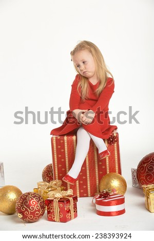 Christmas atmosphere and beautiful smiling blond little girl - stock photo