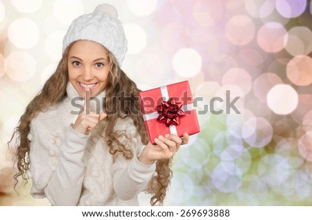 Christmas. Attractive Young Woman in Sweater with Red Gift Box - stock photo