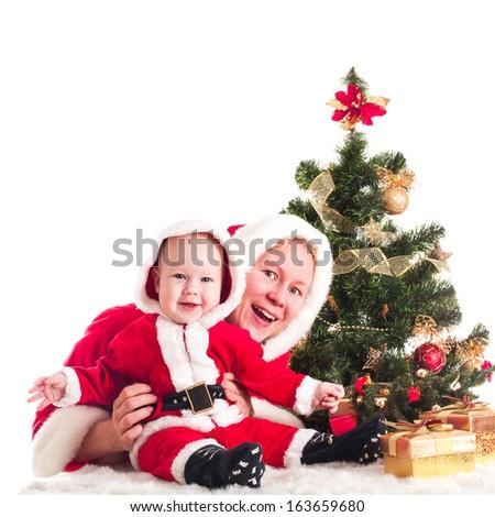 Christmas baby and mom - stock photo