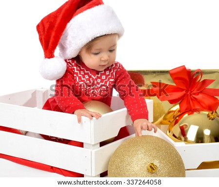 Christmas baby child in santa hat holding gold ball decoration near present gift box. New Year 2016 holiday concept isolated on a white background - stock photo
