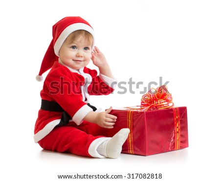 Christmas baby with gift box in Santa's suit isolated - stock photo