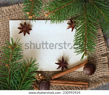 Christmas background and spices, anise, nuts, cinnamon, paper - stock photo