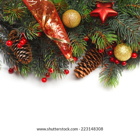 Christmas background. Christmas boarder with fir tree branch with cones and ornament. Christmas baubles in golden and red colour. Close up with copy space. Winter holidays concept.  - stock photo
