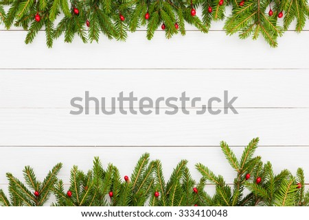 Christmas background. Christmas fir tree with decoration on white wooden board background with copy space  - stock photo