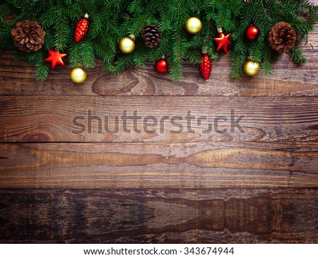 Christmas background. Christmas fir tree with gift boxes and decoration on wooden board