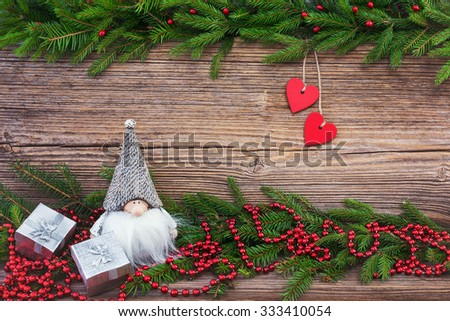 Christmas background. Christmas fir tree with red hearts and decoration on old wooden board background. Toned - stock photo